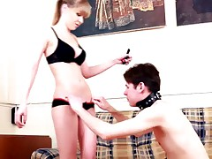 Innocent-looking blonde almost makes slave choke during facesitting shoot.