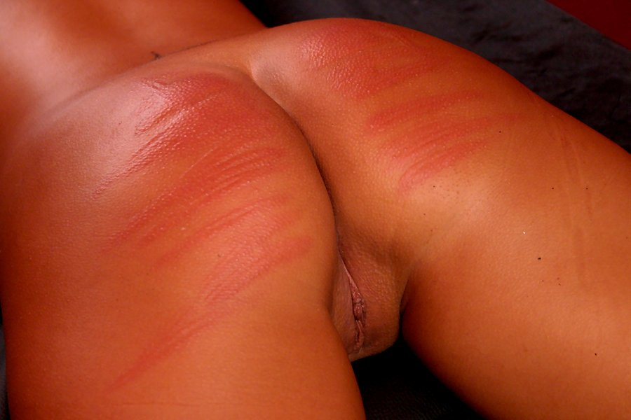 Caning her ass