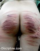 A girl brutally caned, pic #7