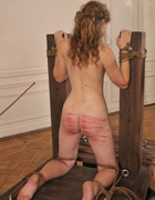 Girl humiliated and caned severely, pic #13
